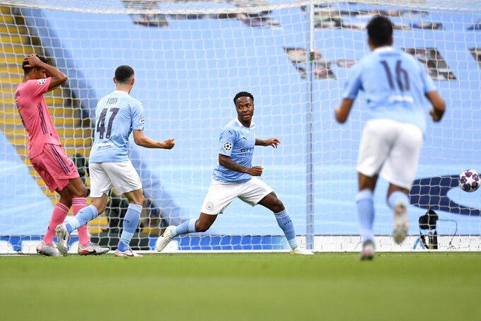 Manchester City's Raheem Sterling celebrates after scoring his side's first goal during the Champions League, round of 16, second leg soccer match between Manchester City and Real Madrid at the Etihad Stadium stadium in Manchester, England, Friday, Aug. 7, 2020. (Peter Powell/Pool Photo via AP)