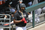 Chicago White Sox's Eloy Jimenez looks towards the field during baseball practice at Guaranteed Rate Field in Chicago, Thursday, July 9, 2020. (AP Photo/Nam Y. Huh)