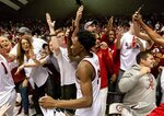 FILE - In this Jan. 5, 2019, file photo, Alabama guard/forward Tevin Mack (34) celebrates with fans after a 77-75 upset win over Kentucky after an NCAA college basketball game, in Tuscaloosa, Ala. Alabama has beaten one Top 5 team and pushed another down to the wire on the road and also suffered some humbling defeats.  That inconsistency has left the Crimson Tide (15-11, 6-7 Southeastern Conference) in a precarious position in the team's bid to make a second straight NCAA Tournament. (AP Photo/Vasha Hunt, File)