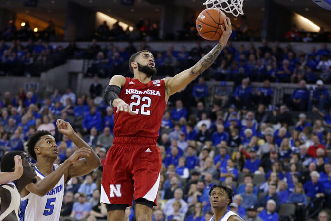 Nebraska's Haanif Cheatham (22) goes for a layup against Creighton's Ty-Shon Alexander (5) during the second half of an NCAA college basketball game in Omaha, Neb., Saturday, Dec. 7, 2019. Creighton won 95-76. (AP Photo/Nati Harnik)