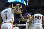 Auburn guard Samir Doughty (10) celebrates a score and foul called against Georgia with teammates during the second half of an NCAA college basketball game Saturday, Jan. 11 2020, in Auburn, Ala. (AP Photo/Julie Bennett)