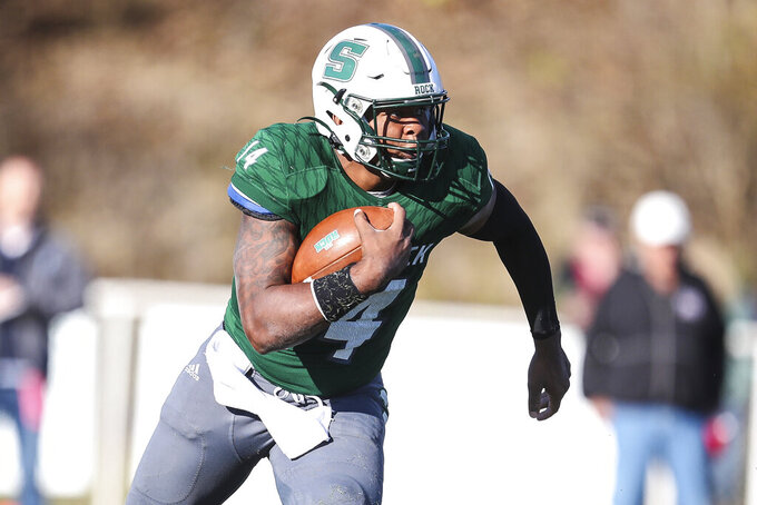 In this Oct. 12, 2019 photo provided by Slippery Rock University Athletics, Slippery Rock quarterback Roland Rivers III carries the ball during an NCAA college football game against Indiana, Pa., University in Slippery Rock, Pa. Rivers was selected to the first team of the Associated Press  Division II All-America football team, Wednesday, Dec. 18, 2019. (Slippery Rock University Athletics via AP)