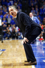 Kentucky head coach John Calipari questions a call in the second half of an NCAA college basketball game against Mississippi in Lexington, Ky., Saturday, Feb. 15, 2020. Kentucky won 67-62. (AP Photo/James Crisp)