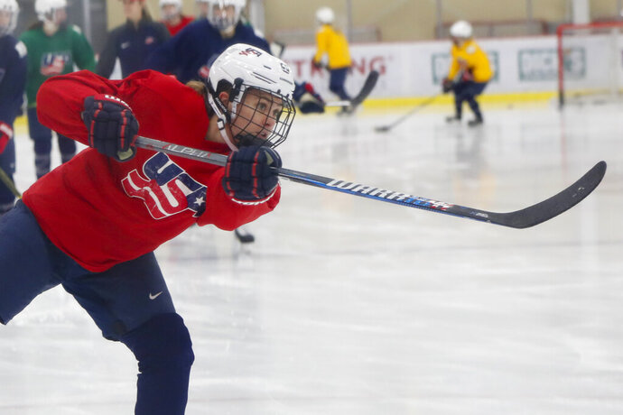 In this Monday, Nov. 4, 2019, photo, Alexandra Carpenter goes through drills while playing with the U.S. Women's National hockey team in Cranberry Township, Butler County, Pa., ahead of scheduled exhibition games against Canada. Carpenter, college hockey's top player in 2015 and daughter of former NHL star Bobby Carpenter, is also leading Russia's Women's Hockey League in scoring while playing for the Chinese-based Shenzhen KRS Vanke Rays. (AP Photo/Keith Srakocic)