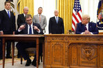 President Donald Trump listens as Serbian President Aleksandar Vucic speaks after participating in a signing ceremony in the Oval Office of the White House, Friday, Sept. 4, 2020, in Washington. (AP Photo/Evan Vucci)