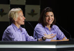 FILE - In this May 15, 2015, file photo, Beth Paretta, left, and driver Katherine Legge announce the formation of Grace Autosport, the first all female IndyCar Series racing team during a press conference at Indianapolis Motor Speedway in Indianapolis. The effort stalled when Paretta's team couldn't find a suitable car. Paretta and Simona de Silvestro will be teaming up to put another woman on the Indianapolis 500 starting grid this May. On Tuesday, Jan. 19, 2021, Paretta Autosport and IndyCar officials announced they would work together to put a predominantly women-run team in the series' biggest race as part of an outreach to create more diversity in motorsports. (AP Photo/Michael Conroy, File)