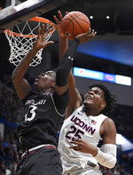 Connecticut's Josh Carlton (25) blocks a shot attempt by Cincinnati's Tre Scott (13) during the second half of an NCAA college basketball game, Sunday, Feb. 24, 2019, in Hartford, Conn. (AP Photo/Jessica Hill)