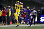 Los Angeles Rams wide receiver Cooper Kupp catches a pass in front of Baltimore Ravens cornerback Jimmy Smith during the second half of an NFL football game Monday, Nov. 25, 2019, in Los Angeles. (AP Photo/Marcio Jose Sanchez)