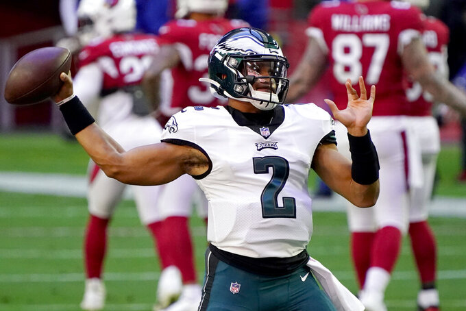 Philadelphia Eagles quarterback Jalen Hurts (2) warms up prior to an NFL football game against the Arizona Cardinals, Sunday, Dec. 20, 2020, in Glendale, Ariz. (AP Photo/Rick Scuteri)