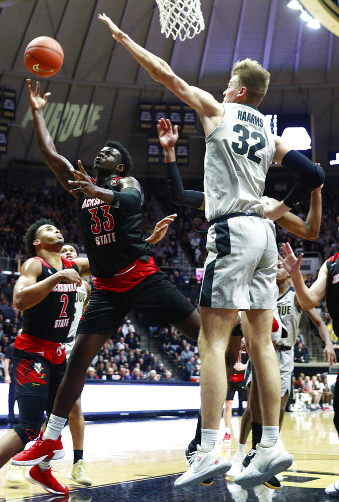 Jacksonville State guard DeTorrion Ware (33) shoots the ball defended by Purdue center Matt Haarms (32) during an NCAA college basketball game Saturday, Nov. 23, 2019, in West Lafayette, Ind. (AP Photo/R Brent Smith)