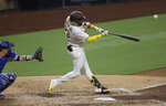 San Diego Padres' Fernando Tatis Jr. hits a two-run home run during the fifth inning of a baseball game against the Los Angeles Dodgers, Wednesday, Aug. 5, 2020, in San Diego. (AP Photo/Gregory Bull)