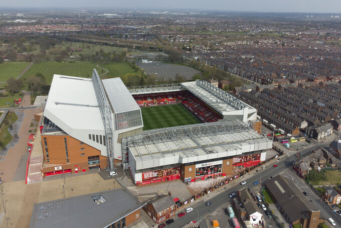 """Liverpool's Anfield Stadium is seen after the collapse of English involvement in the proposed European Super League, Liverpool, England, Wednesday, April 21, 2021. Liverpool owner John W Henry has apologised to the club's supporters for the """"disruption"""" caused by the proposed European Super League (ESL). (AP Photo/Jon Super)"""