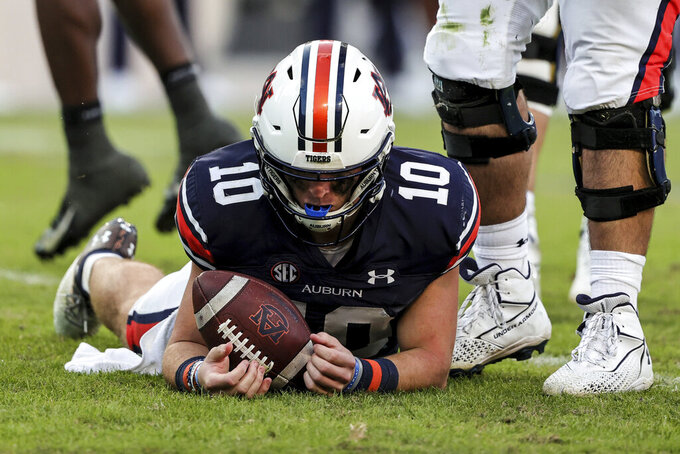 Auburn quarterback Bo Nix (10) lies on the ground after a sack during the second half of an NCAA college football game against Georgia Saturday, Oct. 9, 2021, in Auburn, Ala. (AP Photo/Butch Dill)