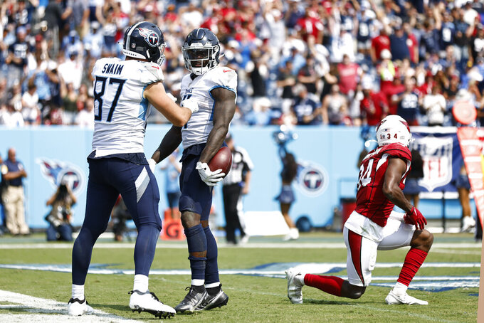 Tennessee Titans wide receiver A.J. Brown, center, is congratulated by tight end Geoff Swaim (87) after Brown scored a touchdown against the Arizona Cardinals in the second half of an NFL football game Sunday, Sept. 12, 2021, in Nashville, Tenn. (AP Photo/Wade Payne)