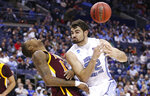 North Carolina's Luke Maye, right, loses control of the ball after colliding with Iona's Tajuan Agee during the second half of a first-round game in the NCAA men's college basketball tournament in Columbus, Ohio, Friday, March 22, 2019. North Carolina won 88-73. (AP Photo/Paul Vernon)