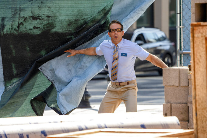 """FILE - This image released by 20th Century Studios shows Ryan Reynolds in a scene from """"Free Guy."""" (Alan Markfield/20th Century Studios via AP, File)"""