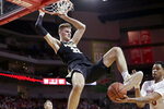 Nebraska's James Palmer Jr. (0) catches the ball following a dunk by Purdue's Matt Haarms (32) during the second half of an NCAA college basketball game in Lincoln, Neb., Saturday, Feb. 23, 2019. (AP Photo/Nati Harnik)