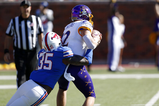 East Carolina quarterback Holton Ahlers (12) is sacked by SMU defensive end Delontae Scott (35) during the first half of an NCAA college football game, Saturday, Nov. 9, 2019, in Dallas. (AP Photo/Roger Steinman)