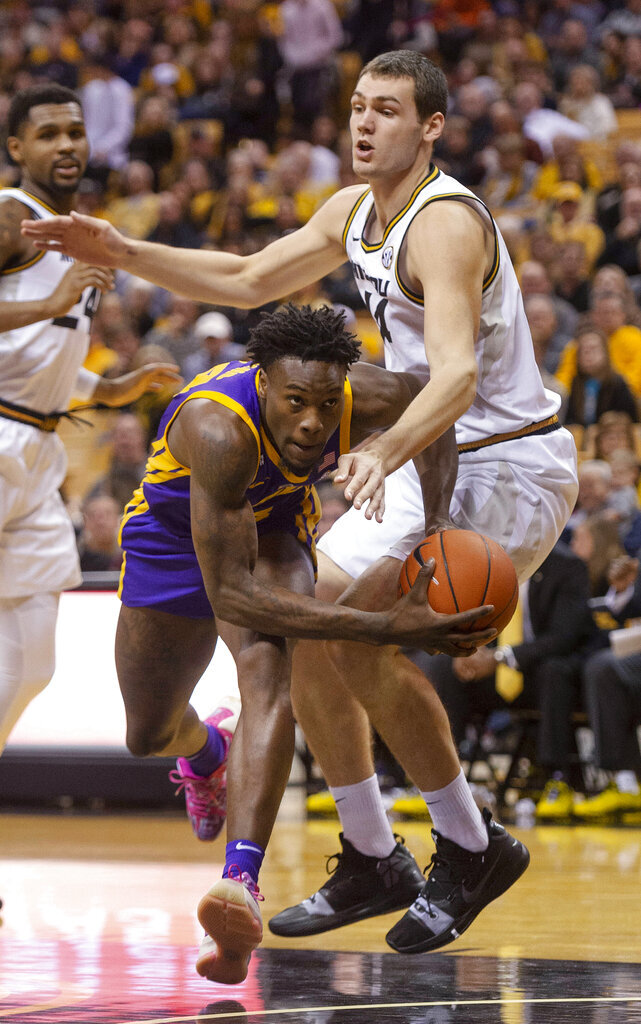 LSU's Emmitt Williams, left, pushes his way past Missouri's Reed Nikko, right, during the first half of an NCAA college basketball game Saturday, Jan. 26, 2019, in Columbia, Mo. (AP Photo/L.G. Patterson)