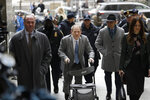 Harvey Weinstein, center, arrives at a Manhattan courthouse for his rape trial in New York, Tuesday, Feb. 18, 2020. (AP Photo/Seth Wenig)