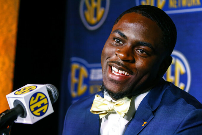 """FILE - In this July 16, 2019, file photo, Tennessee linebacker Darrell Taylor speaks to reporters during the NCAA college football Southeastern Conference Media Days in Hoover, Ala. Taylor recorded eight sacks last year, the most of any Southeastern Conference player who's back this fall. Taylor says he can improve upon those numbers if he gains the consistency that has been missing from his game up to his point. """"He has to bring it,"""" co-defensive coordinator and outside linebackers coach Chris Rumph said. """"He's the face of the program, the defense right now. We're expecting a lot of things out of him.""""(AP Photo/Butch Dill, File)"""