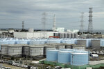 FILE - In this Oct. 12, 2017, file photo, ever-growing amount ofcontaminated, treated but still slightly radioactive, waterat the wreckedFukushima Dai-ichi nuclear plant is stored in about 900 huge tanks, including those seen in this photo taken during a plant tour at Fukushima Daiichi Nuclear Power Plant in Okuma, Fukushima prefecture, northeast of Tokyo. Japan revised a roadmap on Friday, Dec. 27, 2019, for the tsunami-wrecked Fukushima nuclear plant cleanup, further delaying the removal of thousands of spent fuel units that remain in cooling pools since the 2011 disaster. It's a key step in the decadeslong process, underscoring high radiation and other risks. (Pablo M. Diez/Pool Photo via A, File)