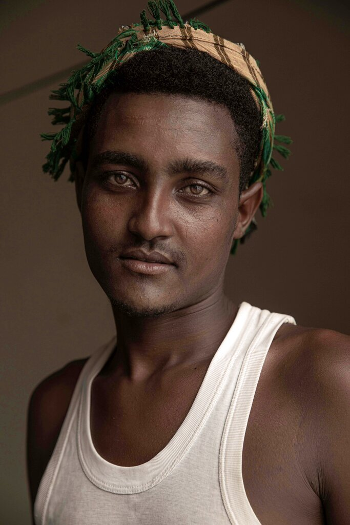 In this July 21, 2019 photo, 20-year-old Hussein Asfar, a migrant from Ethiopia who was a victim of physical abuse when he landed in Yemen, poses for a portrait in the