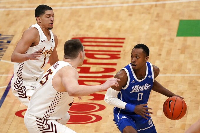 Drake's D.J. Wilkins (0) looks to pass as Loyola of Chicago's Lucas Williamson (1) and Cameron Krutwig defend during the first half of the championship game in the NCAA Missouri Valley Conference men's basketball tournament Sunday, March 7, 2021, in St. Louis. (AP Photo/Jeff Roberson)