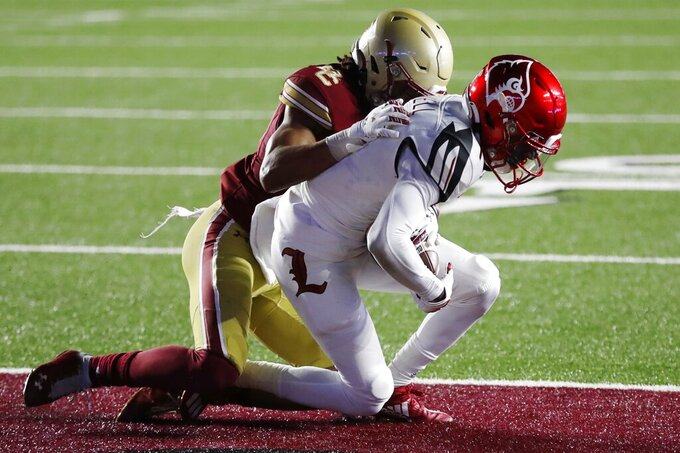 Louisville wide receiver Tutu Atwell, right, makes a touchdown reception against Boston College defensive back Brandon Sebastian during the second half of an NCAA college football game Saturday, Nov. 28, 2020, in Boston. (AP Photo/Michael Dwyer)