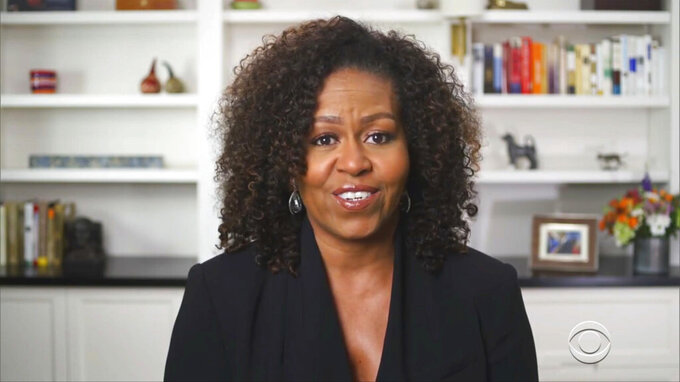 In this video grab issued Sunday, June 28, 2020, by BET, former U.S. first lady Michelle Obama introduces humanitarian award winner Beyonce during the BET Awards. (BET via AP)