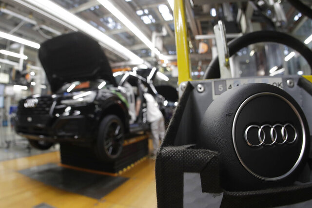FILE- In this March 24, 2018, file photo, part of the assembly line at German car producer Audi plant in Ingolstadt, Germany. The Ingolstadt-based automaker said Tuesday Nov. 26, 2019, that it expected to add 2,000 new positions while Volkswagen subsidiary Audi says it is cutting 9,500 jobs in Germany through 2025.(AP Photo/Matthias Schrader, File)
