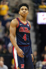 Mississippi's Breein Tyree grimaces after losing a ball out of bounds during the second half of an NCAA college basketball game against Missouri Tuesday, Feb. 18, 2020, in Columbia, Mo. Missouri won 71-68.(AP Photo/L.G. Patterson)