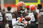Cleveland Browns defensive back Ronnie Harrison catches a pass during practice at the NFL football team's training camp facility, Tuesday, Aug. 17, 2021, in Berea, Ohio. (AP Photo/Tony Dejak)