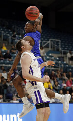 New Orleans guard Damion Rosser (1) passes the ball over Abilene Christian forward Hayden Farquhar, front, during the first half of an NCAA college basketball game for the Southland Conference men's tournament title Saturday, March 16, 2019, in Katy, Texas. (AP Photo/Michael Wyke)
