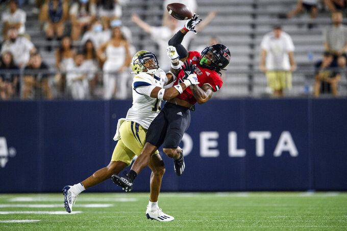Northern Illinois wide receiver Tyrice Richie (3) catches a pass over Georgia Tech defensive back Wesley Walker (13) during the first half of an NCAA college football game, Saturday, Sept. 4, 2021, in Atlanta. (AP Photo/Danny Karnik)