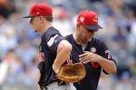 Cleveland Indians starting pitcher Zach Plesac, left, comes out of a baseball game after handing the ball to manager Terry Francona, right, during the third inning against the Kansas City Royals, Thursday, July 4, 2019, in Kansas City, Mo. (AP Photo/Charlie Riedel)