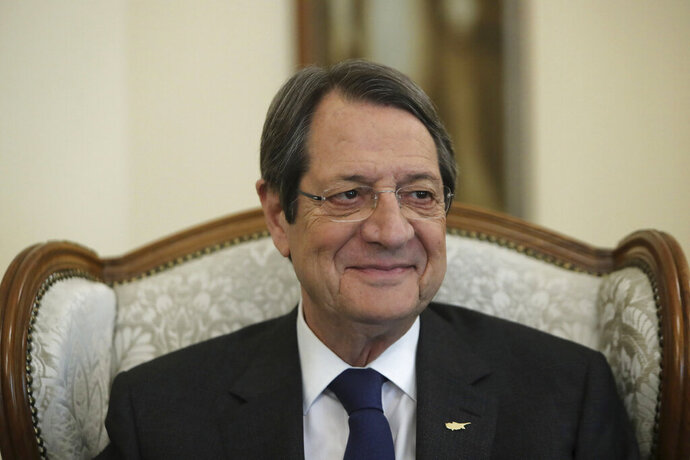 Cyprus' president Nicos Anastasiades smiles during an interview with the Associated Press at the presidential palace in capital Nicosia, Cyprus, Tuesday Sept. 17, 2019. Anastasiades says Turkey's