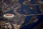 In this Nov. 29, 2017 photo RFK Stadium is visible from Air Force One as it takes off from Andrews Air Force Base, Md. FedEx Field is a concrete relic of stadiums past with a clock ticking on its status as an NFL building. The Washington Redskins' training camp home away from home is only six years old and yet it appears to be on borrowed time. (AP Photo/Andrew Harnik)