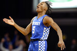 Kentucky guard Immanuel Quickley (5) celebrates after scoring against Vanderbilt during the second half of an NCAA college basketball game Tuesday, Feb. 11, 2020, in Nashville, Tenn. Kentucky won 78-64. (AP Photo/Mark Zaleski)