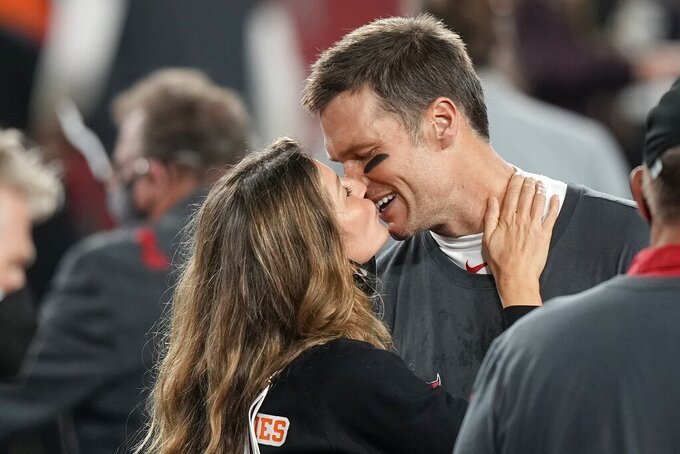 Tampa Bay Buccaneers quarterback Tom Brady kisses wife Gisele Bundchen after defeating the Kansas City Chiefs in the NFL Super Bowl 55 football game Sunday, Feb. 7, 2021, in Tampa, Fla. The Buccaneers defeated the Chiefs 31-9 to win the Super Bowl. (AP Photo/David J. Phillip)