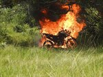 In this image courtesy of Wiririhu Tembe, a motorcycle that belonged to illegal loggers burns after it was set fire by Tembe indigenous people on the Alto Rio Guama indigenous reserve in Para state, Brazil, Tuesday, Aug. 27, 2019. Men from the Tekohaw village spotted loggers using chain saws, trucks and tractors to cut down and haul trees. The indigenous warriors recorded video. Then they intervened, letting the loggers flee before burning their machinery. (Wiririhu Tembé via AP)