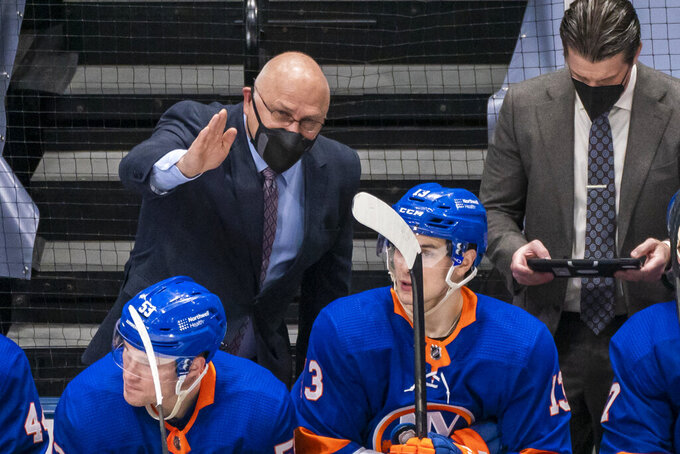 FILE - In this Saturday, April 3, 2021, file photo, New York Islanders coach Barry Trotz speaks to his players during the third period of an NHL hockey game against the Philadelphia Flyers at Nassau Coliseum in Uniondale, N.Y. The Penguins and Islanders meet in Game 1 of their opening-round series on Sunday. The Islanders swept Pittsburgh in the first round of the playoffs in 2019. (AP Photo/Corey Sipkin, File)