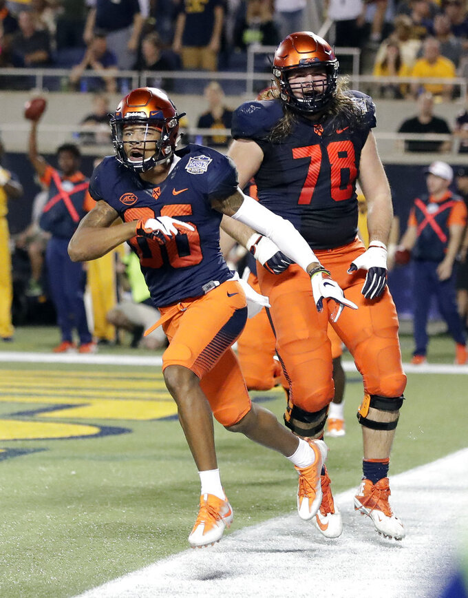 Syracuse wide receiver Trishton Jackson, left, celebrates with offensive lineman Koda Martin (78) after making a touchdown reception against West Virginia during the second half of the Camping World Bowl NCAA college football game Friday, Dec. 28, 2018, in Orlando, Fla. (AP Photo/John Raoux)