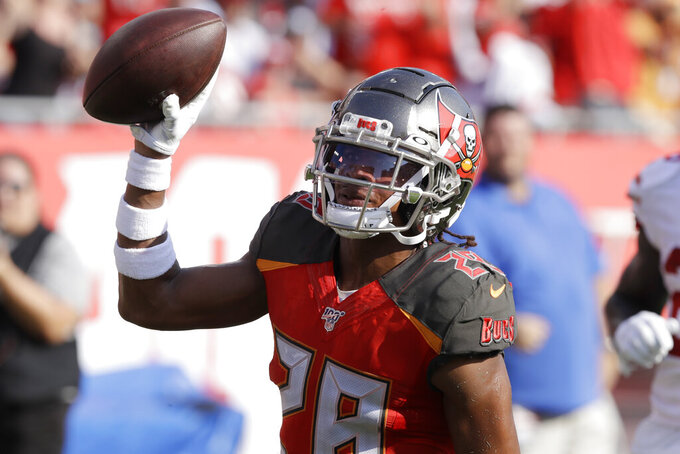 Tampa Bay Buccaneers cornerback Vernon Hargreaves III (28) celebrates in the end zone his touchdown against the Tampa Bay Buccaneers during the first half an NFL football game, Sunday, Sept. 8, 2019, in Tampa, Fla. (AP Photo/Chris O'Meara)