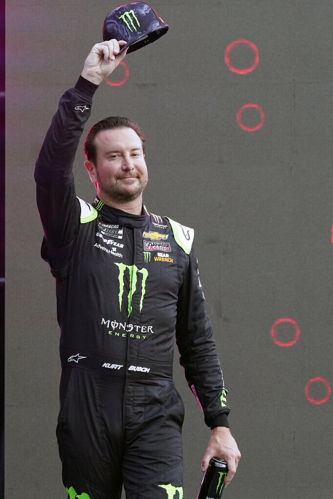 Kurt Busch waves to fans during driver introductions before the NASCAR Cup Series auto race at Daytona International Speedway, Saturday, Aug. 28, 2021, in Daytona Beach, Fla. (AP Photo/John Raoux)