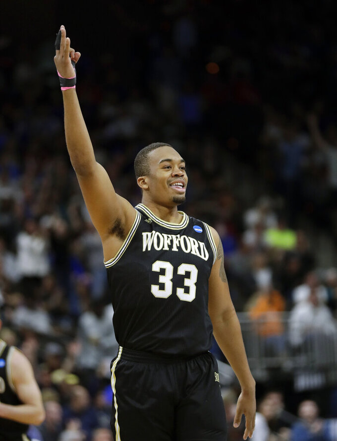 Wofford's Cameron Jackson (33) hold up 3-fingers after sinking a 3-point shot during the first half of a second-round game in the NCAA men's college basketball tournament in Jacksonville, Fla., Saturday, March 23, 2019. (AP Photo/John Raoux)