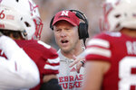 FILE - In this Saturday, Oct. 20, 2018, file photo, Nebraska head coach Scott Frost talks to his players during a timeout in the second half of an NCAA college football game against Minnesota in Lincoln, Neb. Nebraska will play a Bethune-Cookman team Saturday that's lost its last five games against Football Bowl Subdivision opponents by an average of 32 points and has come no closer than three touchdowns in any of them.  (AP Photo/Nati Harnik, File)