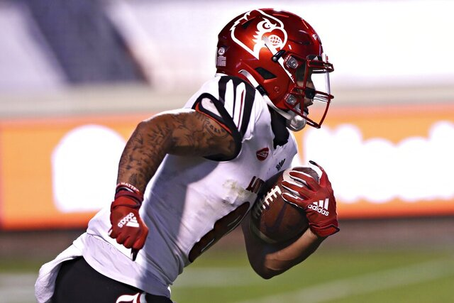 Louisville wide receiver Jordan Watkins (80) runs the ball during an NCAA college football game against Virginia Saturday, Nov. 14, 2020, in Charlottesville, Va. (Erin Edgerton/The Daily Progress via AP)