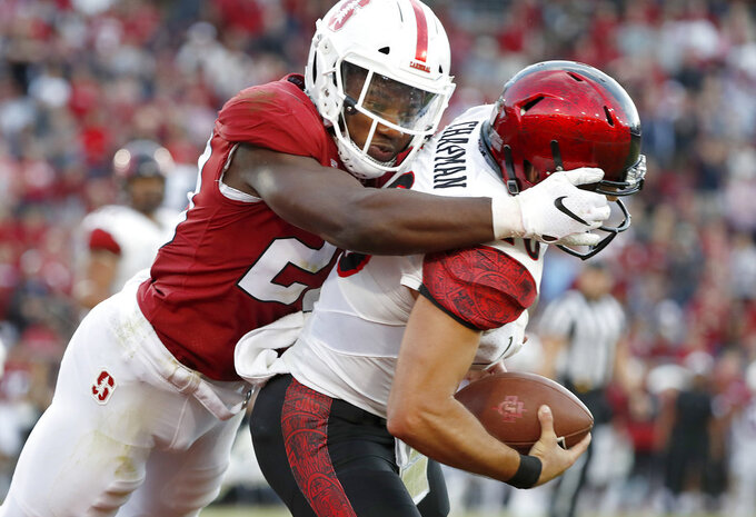 San Diego State quarterback Christian Chapman, right, is tackled in the end zone for a safety by Stanford linebacker Bobby Okereke (20) during the first half of an NCAA college football game Friday, Aug. 31, 2018, in Stanford, Calif. (AP Photo/Tony Avelar)