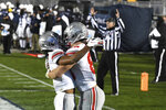 Ohio State tight end Jeremy Ruckert (88) celebrates with Chris Olave following his fourth-quarter touchdown reception against Penn State during an NCAA college football game in State College, Pa., Saturday, Oct. 31, 2020. Ohio State won 38-25. (AP Photo/Barry Reeger)
